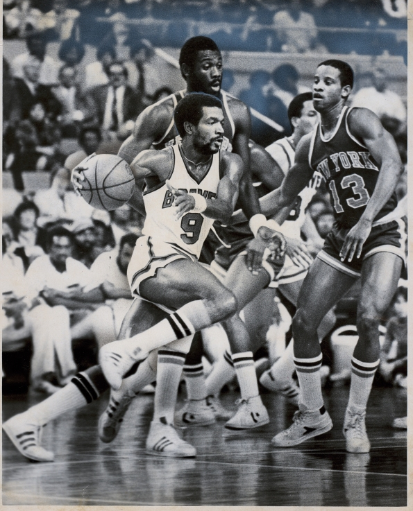 Randy Smith plays against his former teammate Bob McAdoo (left) in 1977
